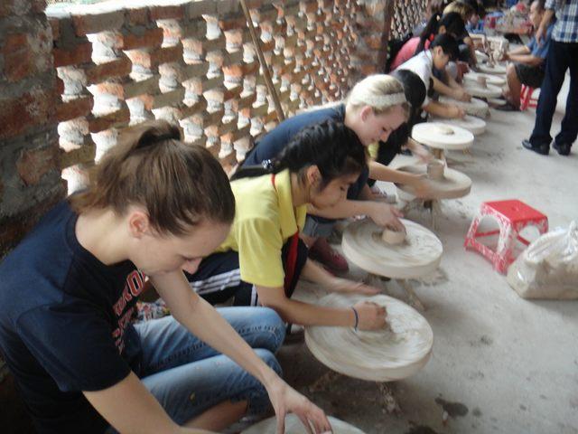 Guests experience in Bat Trang ceramic village