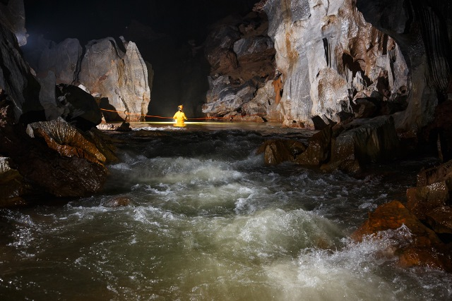 The stream and the water inside the cave as embellished magnificence of Son Doong