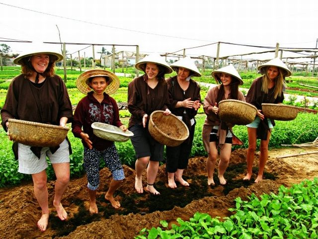 Guests excitedly learning how to sow seeds - Photo by Caitlyn - Hendrik