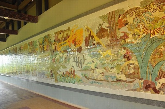 A huge ceramic picture on the wall of Ben Duoc Temple