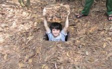 The tourists are fascinated by the discovery of the Cu Chi tunnels