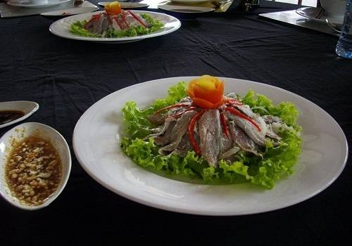 Salad from raw meat or seafood