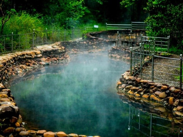 Bathing in hot mineral springs