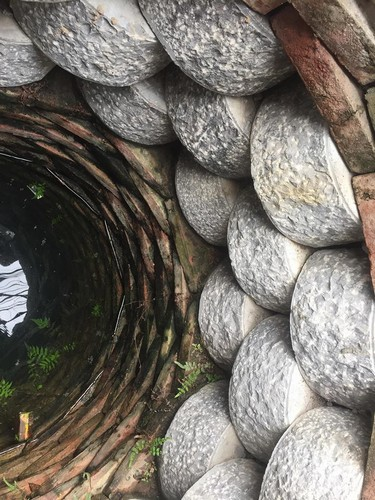 The well has three layers of stone with rounded stone blocks stacked on each other