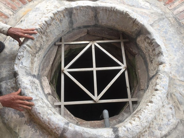 This ancient well is located on the yard of a family in Tam Ky village