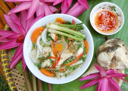 Vietnamese thick noodle soup with snakehead fish