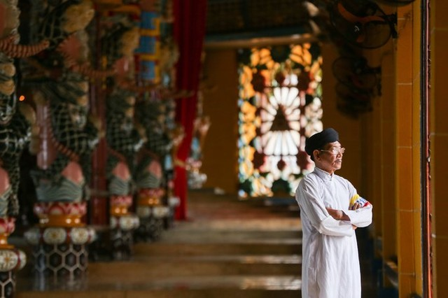 a custodian in Cao Dai temple