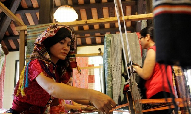 Thai lady is weaving brocade