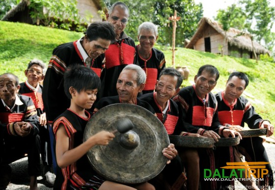 ethnic people with their gongs